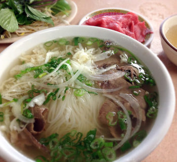 Southern style beef pho with rare beef own the side.