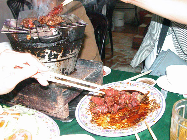 Table grilling at Luong Son Quan Bo Tung Xeo, Saigon