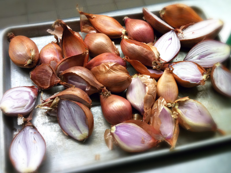 Prepping shallots before roasting