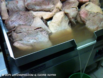 Draining parboiled beef for pho broth